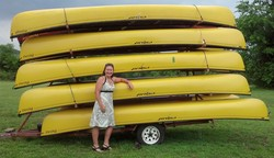 Bri Payne, with a trailer-full of canoes.